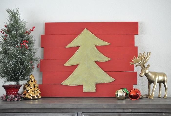 Love this DIY LED Christmas tree wall decor!! Just wait to see how it lights up!