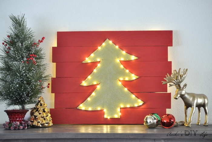 I am in love with this DIY LED Christmas tree wall decor!! This is totally genius!!
