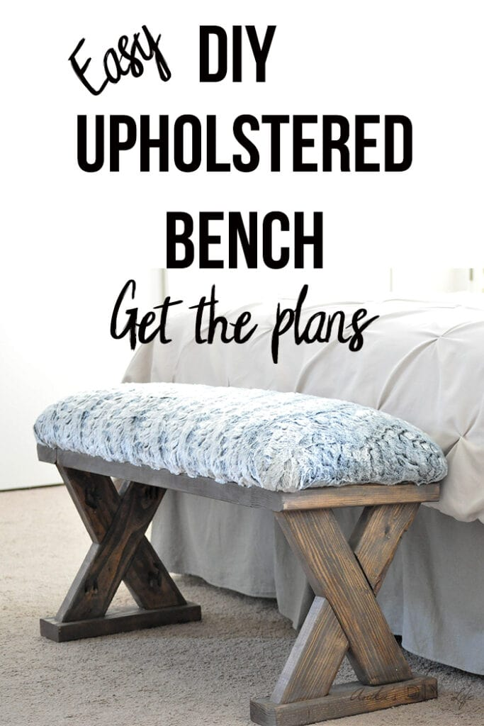 DIY 2x4 bench with upholstered top at the end of the bed with text overlay
