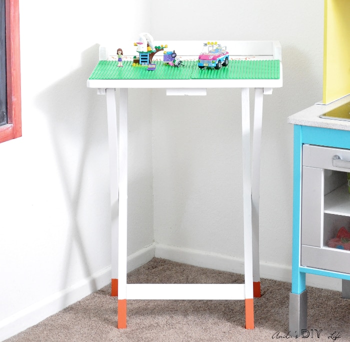 Portable DIY Lego table. An old TV table makeover never looked so cute!