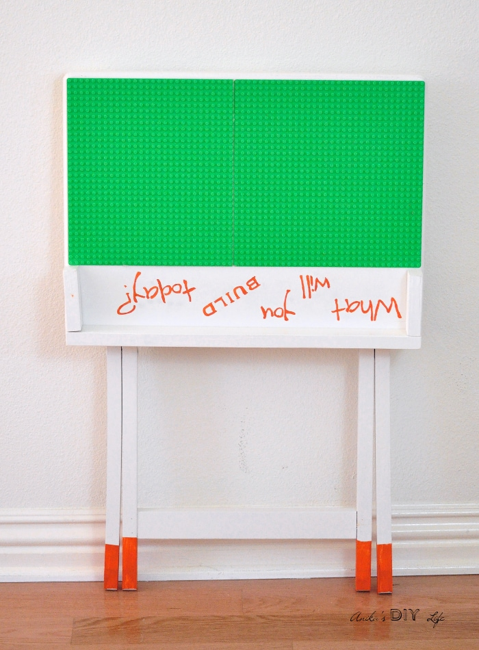 A portable DIY Lego table that can be folded and stored when not in use. An old TV table makeover doesn't get any cuter!