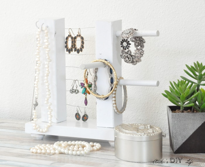 Simple table top jewelry holder on desk with jewelry