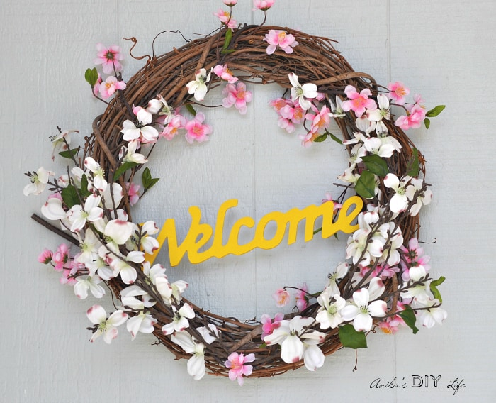 This is such a pretty and bright DIY spring wreath! I love the blossoms and colors! Perfect for spring!