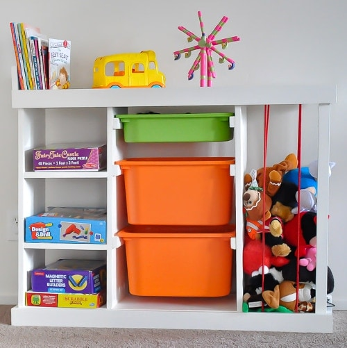 The perfect DIY toy organizer you have been looking for! Easy to build and a spot for stuffed toys, books, board games and all those big and small toys.