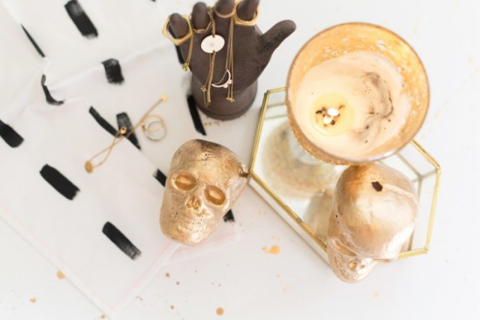You have got to see all the ideas on this page for DIY gold home decor like these gold foil skulls