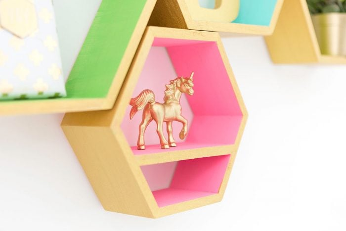 You have got to see all the ideas on this page for DIY gold home decor like these modern geometric shelves