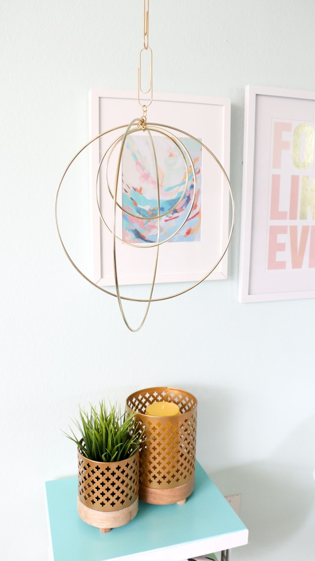 You have got to see all the ideas on this page for DIY gold home decor like this macrame hoop orb