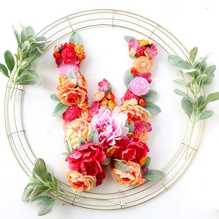 wire wreath with monogrammed flower letter in the middle