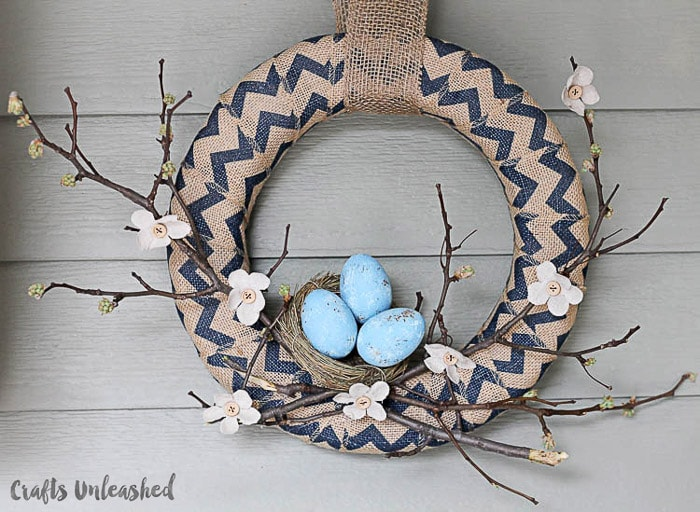 foam wreath wrapped in burlap with blue eggs