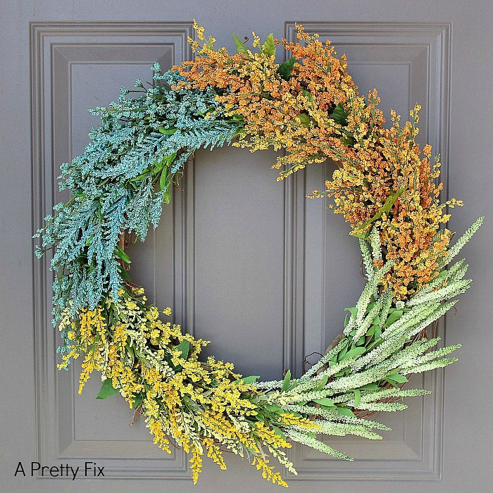 Colorful wreath made with lots of faux  wildflowers