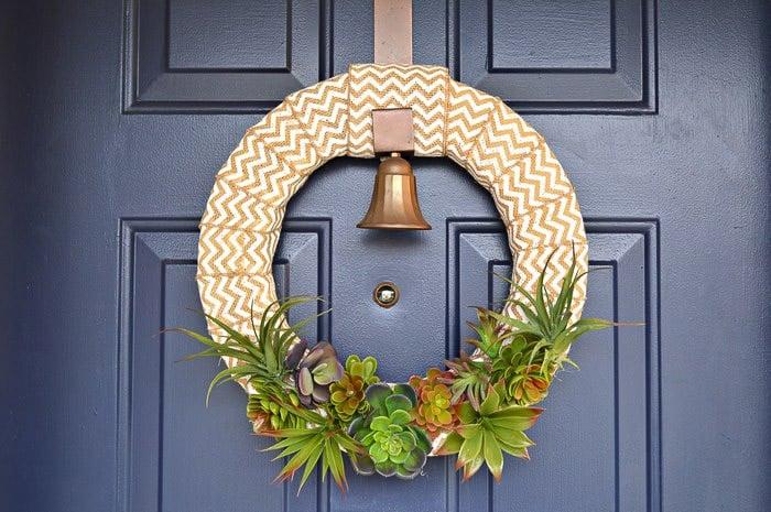burlap wreath with fauz succulents on blue door