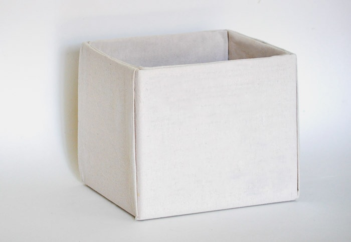 How to make perfect no-sew canvas storage bins by wrapping cardboard boxes in drop cloth. This is a fun easy drop cloth organization project