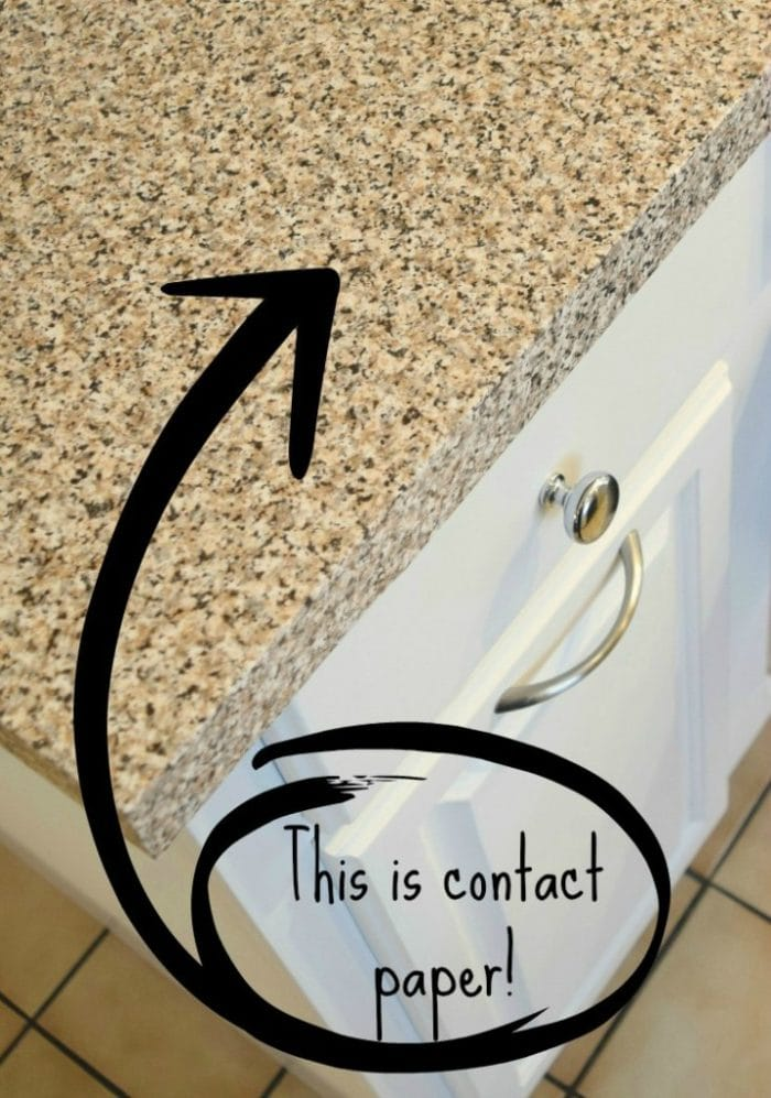 Kitchen countertop covered in granite contact paper