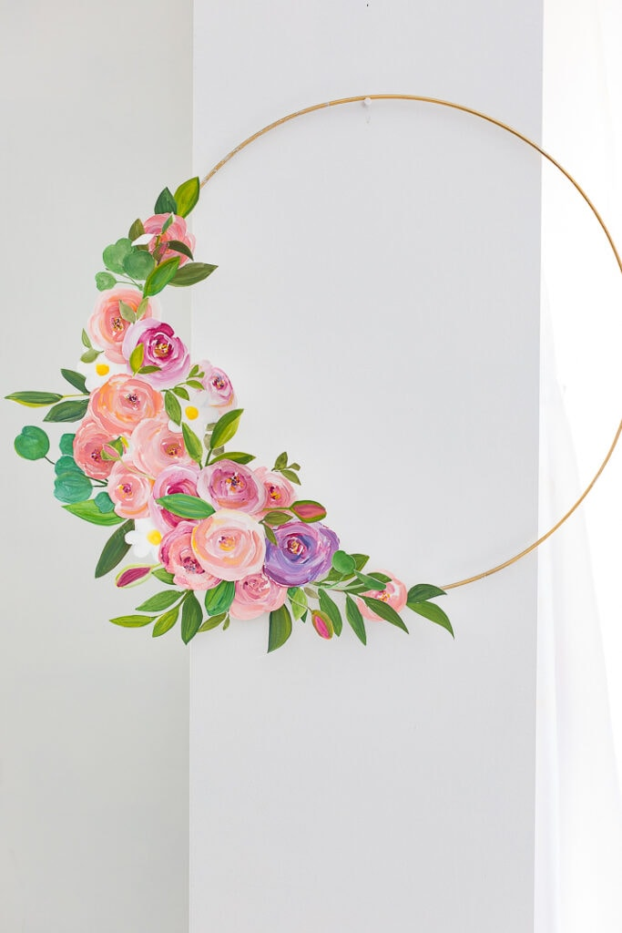 wire hoop with painted roses attached