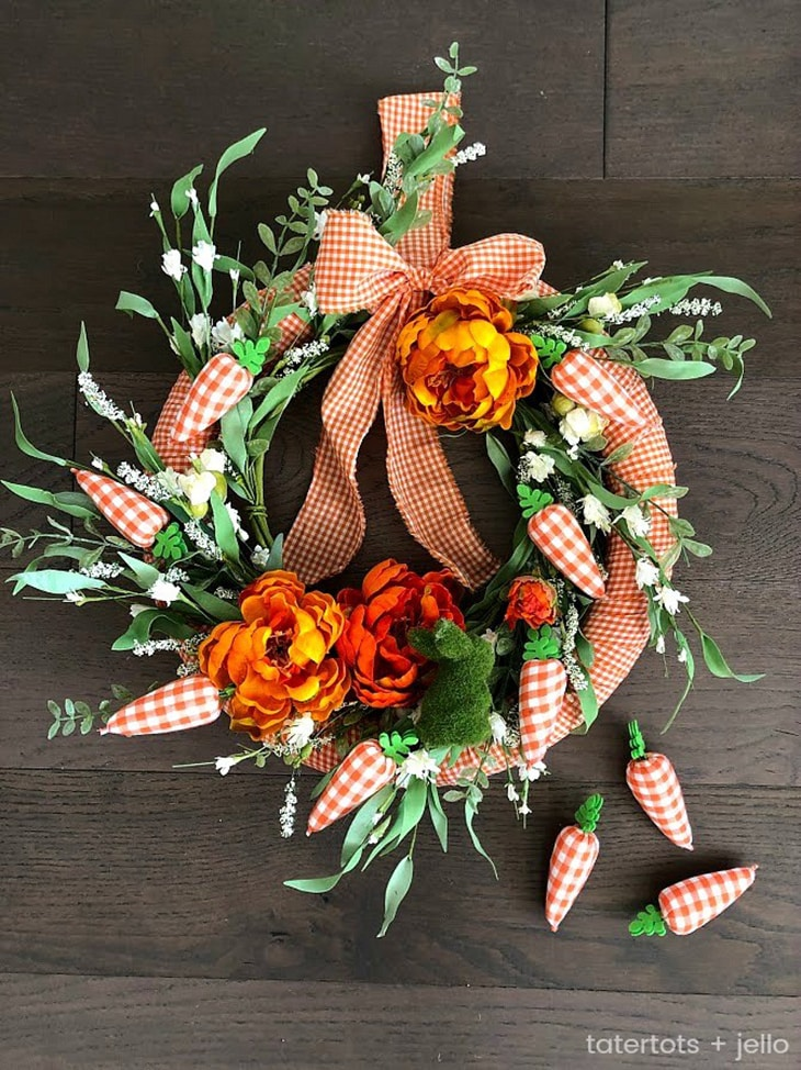 foam wreath form wrapped in orange gingham fabric and attached fabric carrots orange flowers