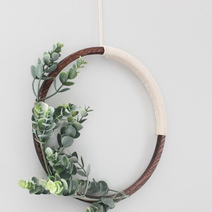 Simple wooden hoop wreath with macrame string and faux eucalyptus
