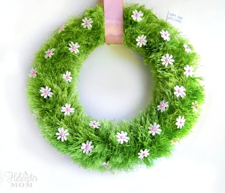 wreath made from faux grass and daisies
