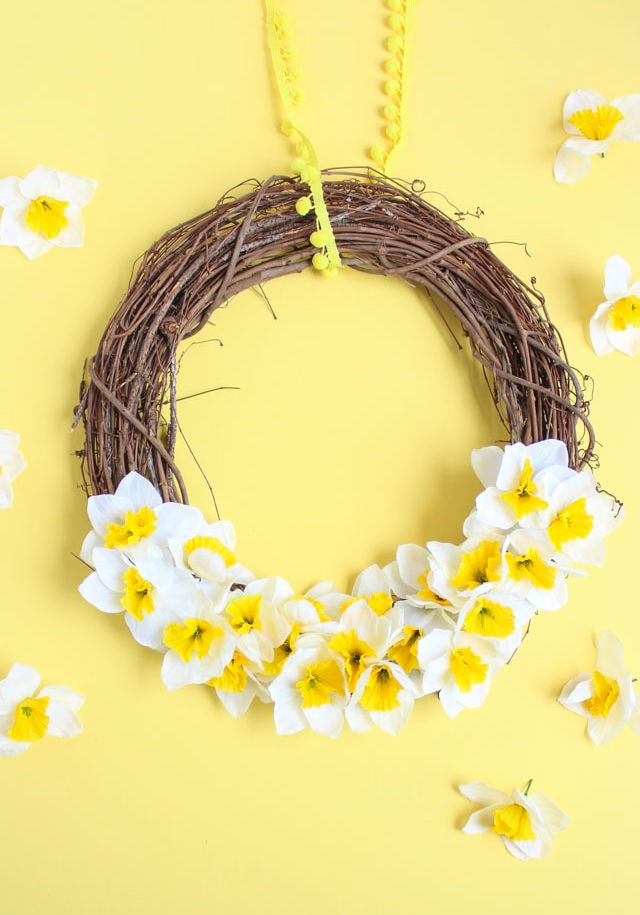 grapevine wreath with white and yellow flowers