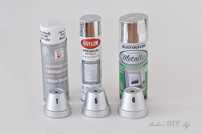 Comparison of 3 matte silver spray paint cans with the painted pots