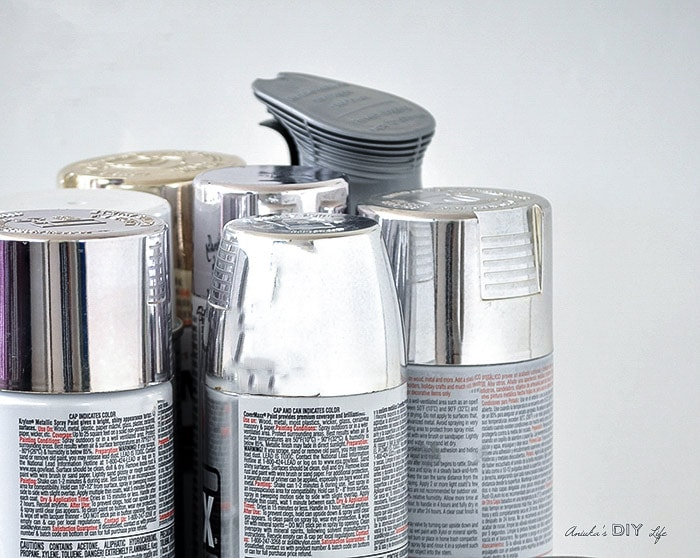 Collection of silver spray paint cans