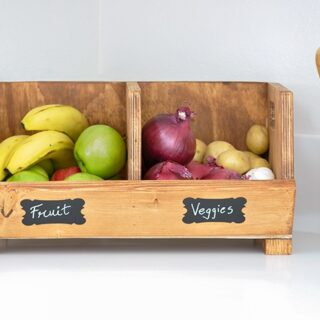 DIY vegetable bins with fruits and vegetables on a kitchen counter