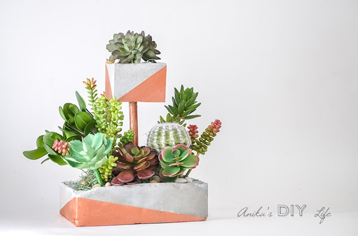 tiered diy concrete planter with copper pipe and paint