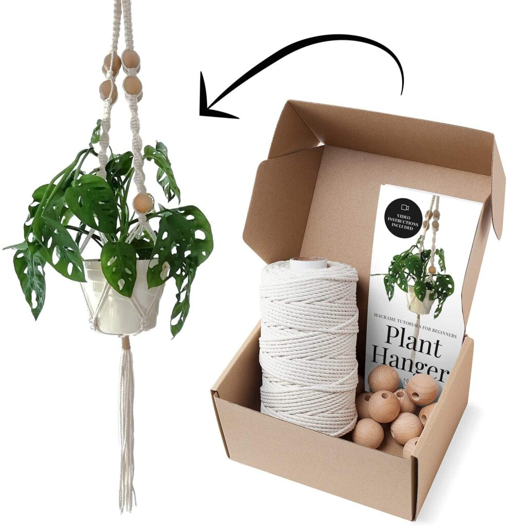finished macrame plant hanger with supplies pictured in a box