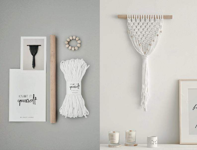 macrame wall hanging with supplies pictured next to it