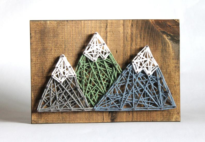 3 mountains made with string art on a wood plaque