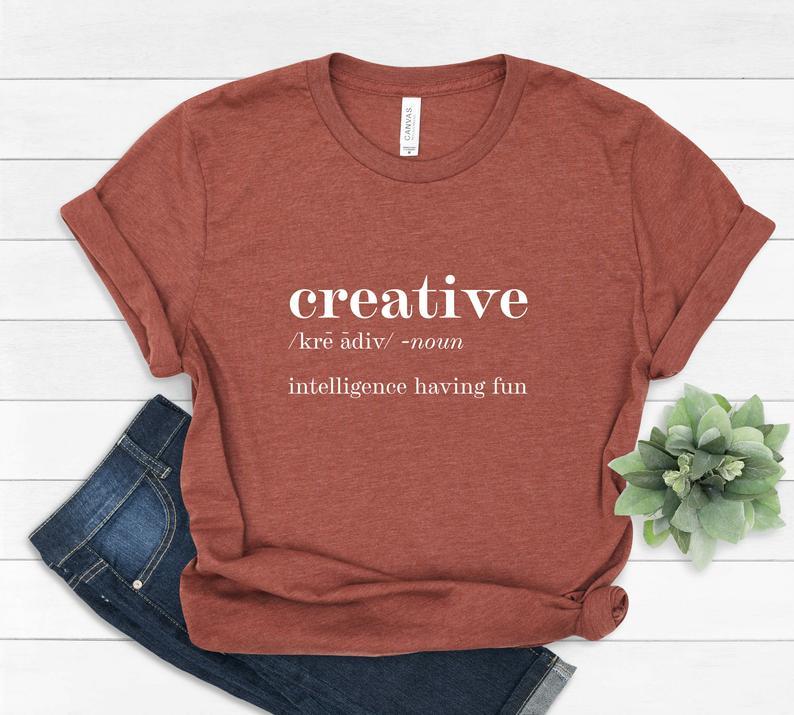 Red t-shirt with text creative /kre adev/ noun intelligence having fun