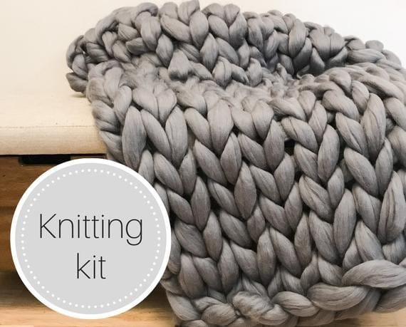 gray arm knitted blanket with text kitting kit