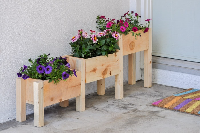 DIY Tiered planter box with flowers in entryway