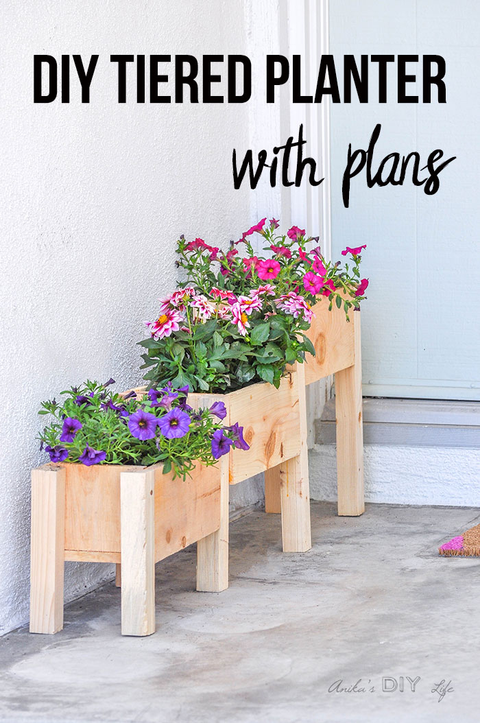 DIY Tiered planter filled with flowers on front porch with text overlay
