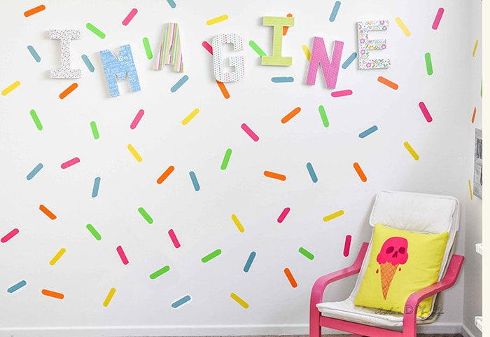 Create a sprinkles accent wall for a colorful playroom decor idea