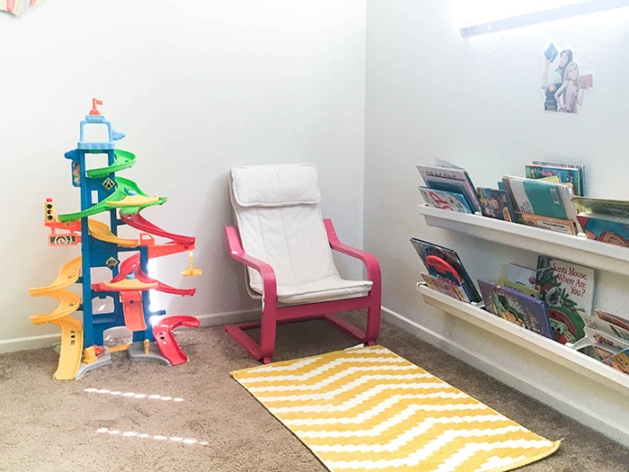 Check out how she made over this oplain corner into a fun colorful playroom!