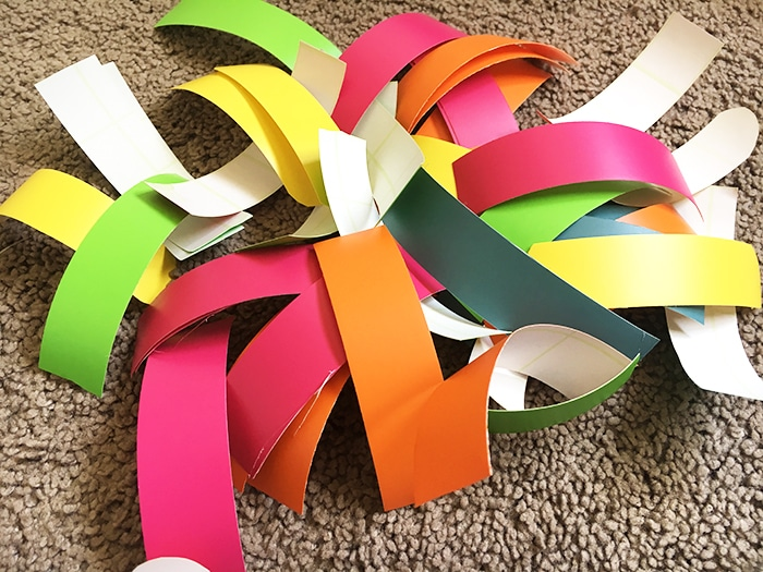 Create a sprinkles accent wall for a colorful playroom decor idea