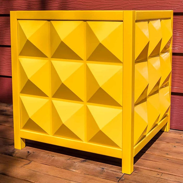 yellow planter box with paneled sides