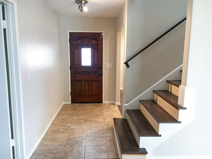 Foyer after changing flooring of the stairway