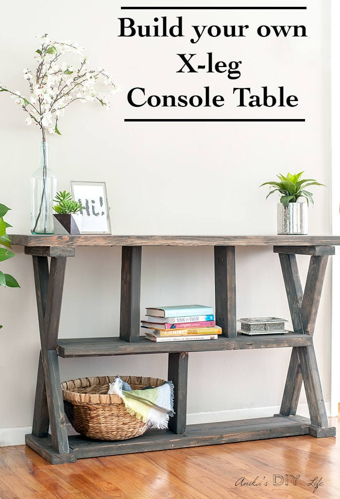 DIY Rustic X-leg Console table that is easy and quick to build with the Free plans. This DIY Entryway table with shelves is made using structural lumber so it's great for your budget too!