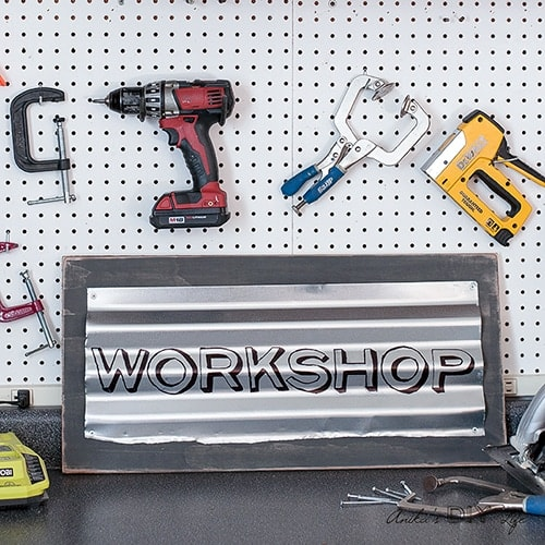 This custom industrial sign is so easy and quick to make! Add lots of character with this easily personalized rustic metal sign to your workshop or home!