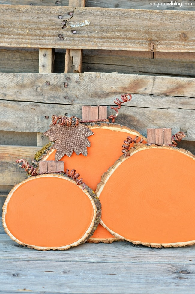 Wood slicec painted orange to make pumpkins