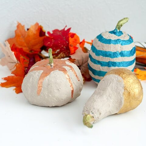 Easy DIY Concrete pumpkins using dollar store pumpkins