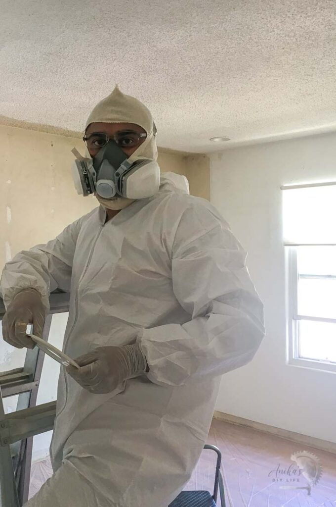 Man dressed for removing popcorn ceiling