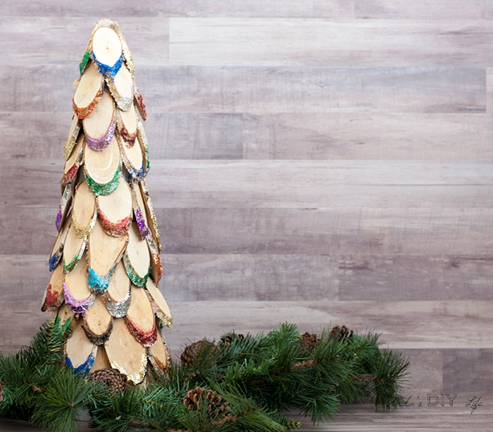 this colorful wood slice christmas tree is the perfect diy wooden christmas decoration add lots of bright sparkle to your christmas decor - Diy Wood Christmas Decorations