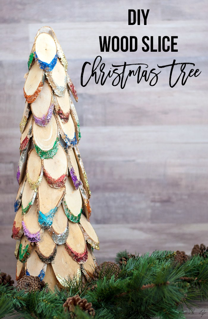 Colorful and glittery wood slice christmas tree with text overlay