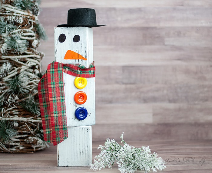this diy wood block snowman is a super easy and cute christmas decor idea this snowman made from wood is easy to store and use every christmas and winter