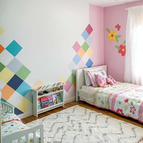 A colorful boy-girl shared bedroom to blow your mind! Bring each kids personality into the room and make it work together!
