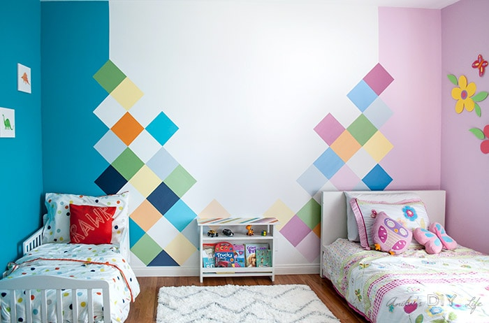 This boy-girl shared bedroom is so amazing! It shows each kids personality so well!