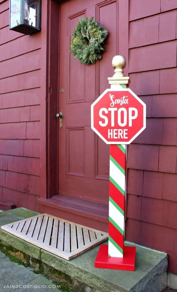 Santa Stop Here Pole with candy cane strips on pole