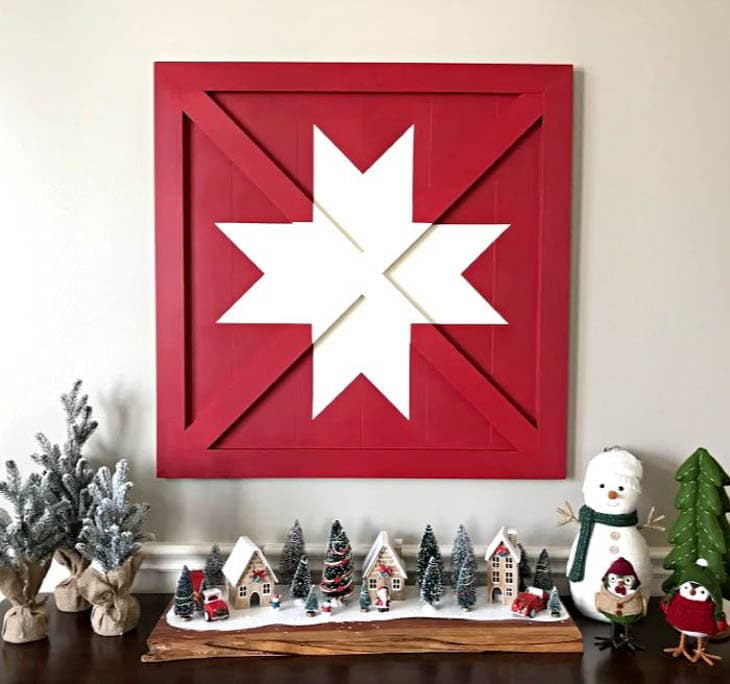Red barn quilt with white star